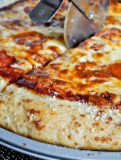 Garlic Bread Pizza Crust - we made this tonight and it was delicious! Modifications: -1 1/2 cups of whole wheat flour and 1 cup of all purpose flour. We used a Kitchen Aid to knead it so we did not need the extra 1/2 cup of flour. -Cover entire crust with the butter, garlic and parm cheese mixture.
