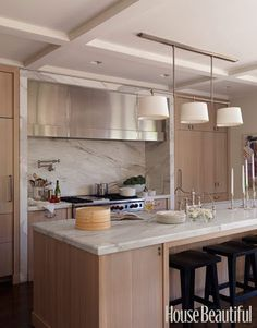 Does anyone have pictures of natural maple cabinets and White Carrara countertops? Honed? A friend has chosen the cabinets, and the walls have been painted Benjamin Moore Nimbus [a gray]. The countertops will most likely be White Carrara marble. Please share any photos so I can share how this might ...