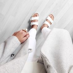 White birkenstocks, white jeans, light grey coat and a lovely pearl ring. What a great outfit idea