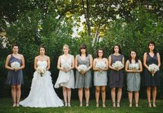 We love these bridesmaids in varying grey dresses of their choice! Photo by Apryl Ann Photography. #wedding #bridesmaid #grey