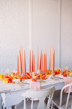 tall taper candle centerpiece, styling by Sarah Park Events, photo by Sweet Root Village http://ruffledblog.com/orange-crush-wedding-ideas #orange #weddingideas #centerpieces