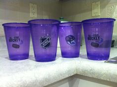 """Used temporary hockey tattoos on boys drinking cups in team color"""" purple"""". Name written on other side with sharpie --- at hockey party"""