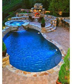 Inground pool freeform concrete pool with an 8\' round spa. The ...