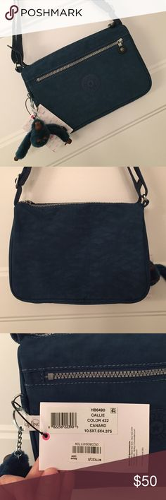 New NWT kipling Callie purse crossbody bag canard New. Excellent condition. Never used. Style - Callie. Color - canard. Dark teal / turquoise color. Crinkle. Krinkle. The monkey is named Michele.  Approx 10.5 x 7.5 x 4.375 Kipling Bags Crossbody Bags