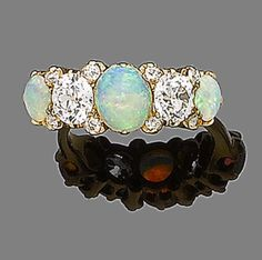 An opal and diamond five-stone ring, by Tiffany & Co., first quarter of the 20th century  The old brilliant-cut diamonds between three cabochon opals, accented with similarly-cut diamond points, diamonds approx. 1.30ct total, rubbed signature Tiffany & Co.