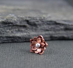 This tiny lotus blossom is a must for your helix earring collection! Blossom is made of 3 layers of copper and measures about 9-10 m in width. The