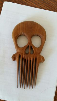 Wooden skull hair comb