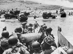American soldiers and supplies arrive on the shore of the French coast of German-occupied Normandy during the Allied D-Day invasion on June 6, 1944 in World War II.