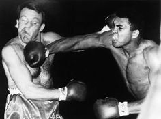 Cassius Clay vs. Henry Cooper.   Cooper was one of the few to drop Ali, but Ali returned the favor as you can see in this picture.
