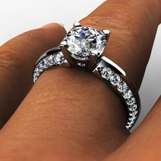 White gold four prong diamond engagement ring with small graduated diamonds