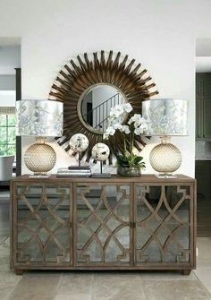 The Chic Technique Simply Gorgeous Entryway Or Foyer A Mirrored Buffet With Decorative Curved Wood Trim Is Dressed Glass Orbs Lamps And Shades
