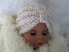 Adorable handknit baby turban. Turban beanie Made with soft mohair yarn for babys comfort.  The yarn is so pretty - off white with some pink yellow