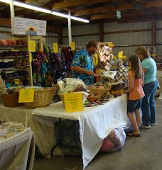 Hoosier Hills Fiber Festival.    June, Johnson County, Indiana.  Central Indiana.   Classes, Vendors, fiber art, competitions, fleece show, roving, yarn, hand dyed, knitting, weaving, spinning, spinning wheels, crochet, supplies, equipment, felting, rug hooking, dyeing, books. Roving Yarn, Crochet Supplies, Spinning Wheels, Art Competitions, Loom Weaving, Rug Hooking, Farmers Market, Felting, Fiber Art