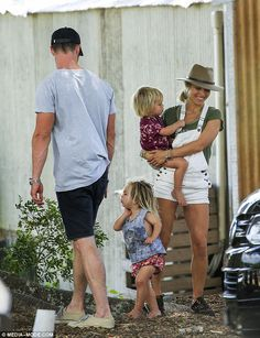 Cool and casual: The mother-of-three accessorised with simple black trainers and a stylish...
