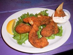 Grouper Fingers - fresh and local!  Seasoned and lightly breaded in our cajun mix...fried crisp and served with yummy tartar sauce!