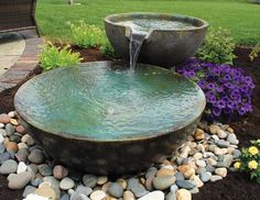 A small fountain enhances backyard relaxation
