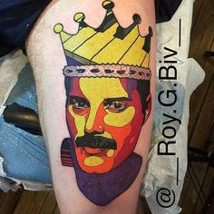 Pop art Freddie Mercury portrait tattoo on the left thigh.