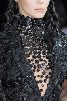 Button Couture - black button and bead embellished surface; close up fashion details // Alexander McQueen