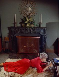 """Kim Novak and her cat Pyewacket cast a love spell on James Stewart in """"Bell, Book and Candle"""" (dir. Richard Quine, 1958)"""