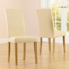 Here's our #ivory PU #chair, with solid #Oak frame, to match your #dining #table. Available in our #Dubai showroom.