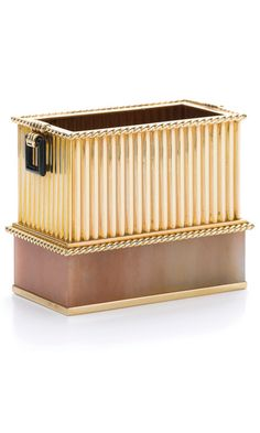 Rose quartz, onyx and gold cigarette box, Cartier, 1920s The rectangular box of rose quartz and reeded gold, accented with a gold rope motif and onyx handles, measuring approximately 70 x 40 x 60mm, signed Cartier, numbered, gross weight approximately 159 grams.