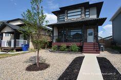 435 Geary Crescent, Saskatoon 4 bedroom, 4 bath 2 Storey home with double detached garage in Saskatoon's Hampton Village neighbourhood Front Verandah, Corner Pantry, Storey Homes, Garden Doors, Functional Kitchen, Vinyl Siding, Detached Garage, Large Windows, The Hamptons