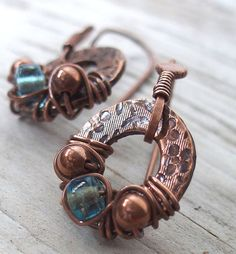 Earrings Copper Aqua Glass with Floral Stamping. $26.00, via Etsy.