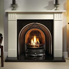 The Gallery Clarendon Limestone Fireplace with Landsdowne Cast Iron Arch consists of the Clarendon Agean limestone mantel, Landsdowne cast iron arched insert with cast back, x hearth and optional gas fire or solid fuel kit for real fires. Diy Outdoor Fireplace, Simple Fireplace, Fireplace Shelves, Cast Iron Fireplace, Farmhouse Fireplace, Living Room With Fireplace, Classic Fireplace, Electric Fireplace, Limestone Fireplace