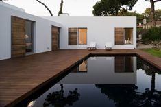 Casa no Banzão ll by Frederico Valsassina Arquitectos. All you need is a pool, and the simplest architecture looks gorgeous Architecture Design, Residential Architecture, Pool Bad, House Shutters, Wooden Shutters, Bungalows, Beautiful Homes, Modern Design, New Homes