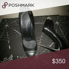 A black 3inch black and silver toe Chanel pump Black and silver toe platform front with heel, worn only once CHANEL Shoes Heels
