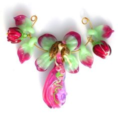 I have a collection of lampwork glass goddess beads, including several by this artist. Beautiful fairy here!