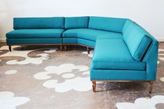 We love our client's mid-century sectional -- here it is all freshly decked-out in a teal solid textile.