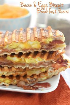 This Bacon and Eggs Biscuit Breakfast Panini is FOUR ingredients, and and all but the last two steps can be done ahead of time making it a fast breakfast!