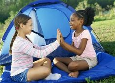 """Using a compass activity. Teach the girls orienteering skills with a compass. Hide several prizes in the woods for the girls to find with a list of directions such as, """"Walk 10 steps, then turn north. Walk until you see a yellow ribbon tied to a tree branch, then travel west."""" Ask a youth camp leader to hide in the trees pretending to be lost and give the girls directions to find her"""