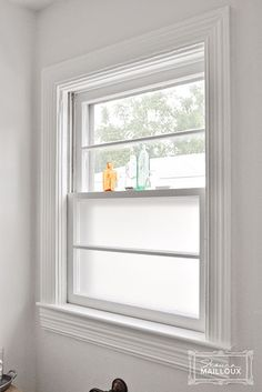 Frosted Window Film - Great way to keep natural light AND privacy. I used this on our hard to curtain side lights!