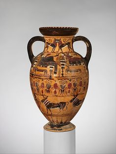 Terracotta neck-amphora (jar), Etruscan ca. 540 BC. Attributed to the Paris Painter. Located in The Metropolitan Museum of Art, New York. More information on this piece is available at their website.