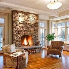 Firewood under fireplace.all about stone veneer stone fireplace surround to ceiling in living area Stone Fireplace Designs, Stone Fireplace Surround, Stacked Stone Fireplaces, Rock Fireplaces, Home Fireplace, Fireplace Remodel, Fireplace Ideas, Fireplace Brick, Fireplace Grate