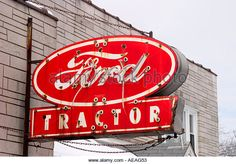 Tight shot of Vintage Ford Tractor sign - Stock Image