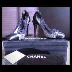 Elegant lace/satin/mesh Chanel pumps. 7.5 Nice size, barely been worn pump. All black except for the mesh, perfect for evening wear. Comes in original box with extra heel grips. A dust bag for each pump (slightly dirty, but can throw in the wash and clean). I absolutely LOVE these pumps but I look like a duck walking in them because they are too big for my foot. I'm hoping these beauties will find a great home and a wearer! CHANEL Shoes Heels
