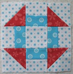 Bee In My Bonnet red and light blue quilted square, my favorite color combination besides orange and blue
