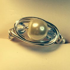 Pearl and blue crystal ring