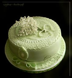Cake with lilly of the valley flowers