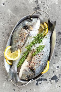 Raw dorado fish with lemon and rosemary. Sea bream or dorada fish by sea_wave. Raw dorado fish with lemon and rosemary. Sea bream or dorada fish Whole30 Fish Recipes, Raw Food Recipes, Dorado Fish, Fish Breading, Rustic Food Photography, Raw Food Diet, Baked Fish, Fish Dishes, Sea Food
