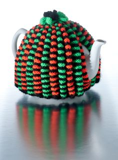by foxymitts.deviantart.com on @deviantART Dotty variation of knitted ribbed tea cosy, would be nice in other colors