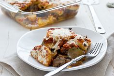 Veggie-polenta bake: Saute some veggies in olive oil (I used an onion, a zucchini, and 8 ounces of mushrooms), slice up a tube of polenta, and layer it with pasta sauce, cheese and the sauteed veggies in a baking dish that's been sprayed with oil. Bake it at 350 degrees for 30 minutes
