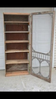 Repurposed old screen door. by suzette