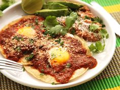 Making huevos rancheros—rancher's-style eggs—is an inherently impromptu and simple affair at home. It's easy for me to think of it as a dish so darn casual that it doesn't even need a recipe. But then I wouldn't be doing my job, now would I? My goal was to come up with a recipe for huevos rancheros with a smoky and wickedly spicy tomato and red chili salsa that requires nothing more than basic supermarket pantry staples. And I wanted it all in under half an hour, because who h...