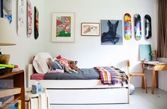 trundle bed. skateboard wall decor.