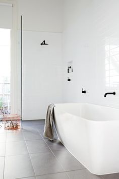 simple design white bathroom black tapware