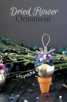 Learn how to make these dried flower ornaments with a simple glass or plastic ball, some dried flowers, and a hot glue gun.